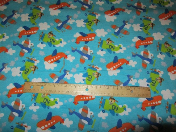 Blue dogs in airplane flying in clouds flannel fabric by for Airplane fabric by the yard
