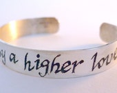 A custom engraved bracelet with lyrics and a man's engraved ring-For Tracie