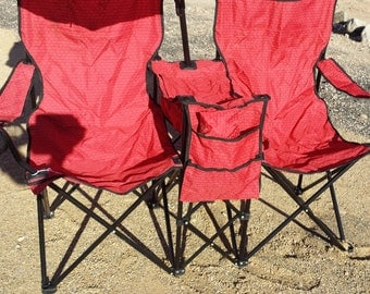 """Dual Beach Chair with cooler in the middle and umbrella with Avon """"A"""" logo"""