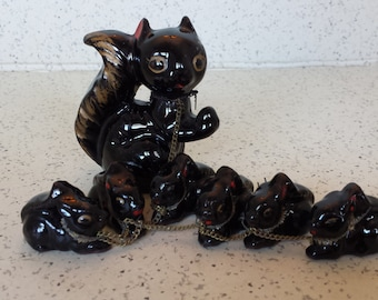 Red Clay Black Glaze Mama Skunk with Six Babies Chained