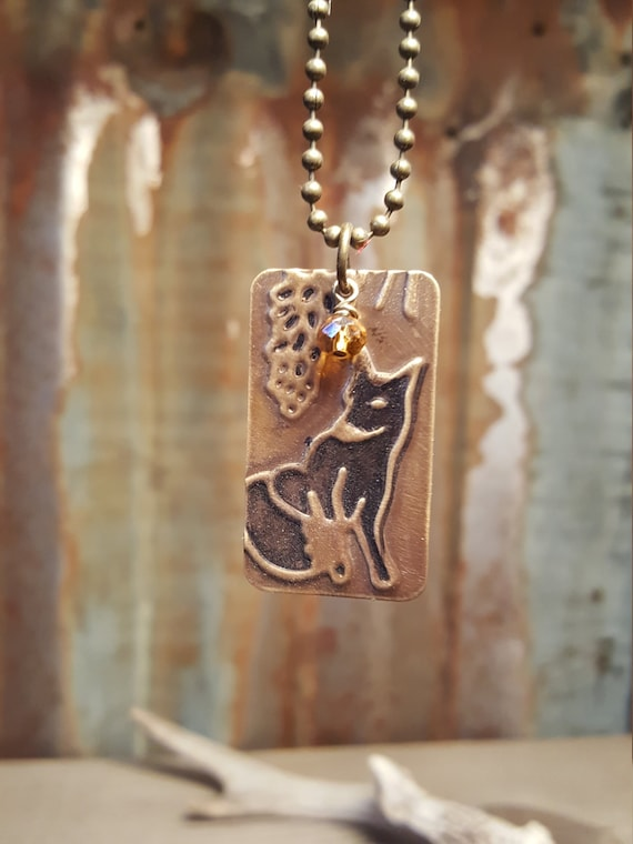 Embossed Copper Necklace with Black Fox and Amber Glass Bead Accent