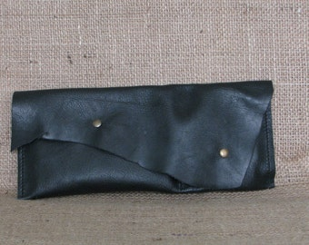 Leather handbag with irregular flap - tobacco case
