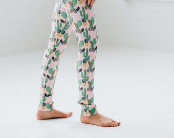 Blue leggings for woman with original illustration of Dinosaurs printed by sublimation ideal for yoga, sport