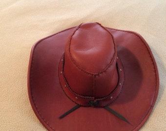 Handmade reddish brown leather hat
