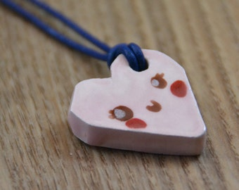 Little Pink Heart Smile Ceramic Medaillon on a Leather Necklace