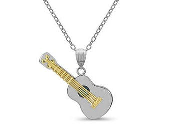 14k solid yellow and white gold guitar pendant with genuine blue topaz stone in center.