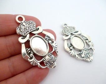 Solid Silver Tone Oval Cameo_PP542008897126_PA/Cameos_Silver emblem inside_ of 12x17 mm_ pack 2 pcs