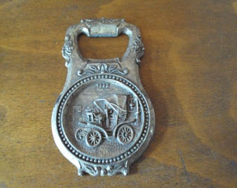 Bottle opener silver metal, a French school of 1970 auto advertising.