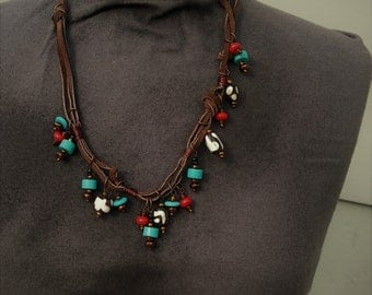 African Style brown leather knot necklace with turquoise, wood and stone dangles