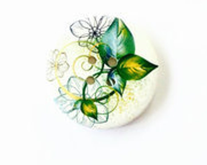 50mm button White button with green yellow blue and black leaves and flowers