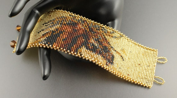 Wild Wyoming Mustang...Loom woven Miyuki Delica Seed Bead Cuff.Amber.Horse Running.Gold Background.Bracelet