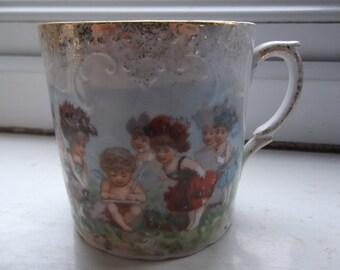 Beautiful Victorian child's mug - children or fairies in flower dresses