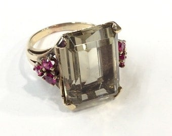 9ct gold big quartz ring with red stones on shoulders