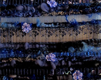 """Textile art, Long woven wall hanging blue """"Blue Cascade"""" sewn with 10 small blue fabric roses"""