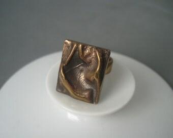 Large elegant modernist solid bronze ring.