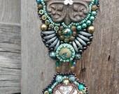 Four Corners/Greek cross/clover Swarovski labradorite and teal bead embroidered pendant