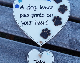 A DOG LEAVES paw prints on your heart - personalised, heart-shaped pet plaque. Wooden. Hand-painted and decorated.