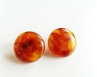 Earring clip orange-mustard.