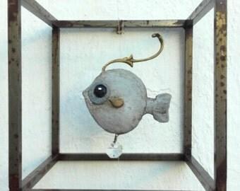fish in a metal tank