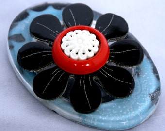 Upcycled blue and black brooch