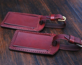 Handmade leather luggage tag with clear plastic window, chestnut brown leather, brass hardware, luggage name tag