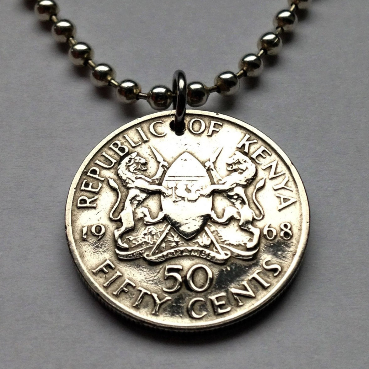 1968 to 1977 kenya 50 cent coin pendant lions east