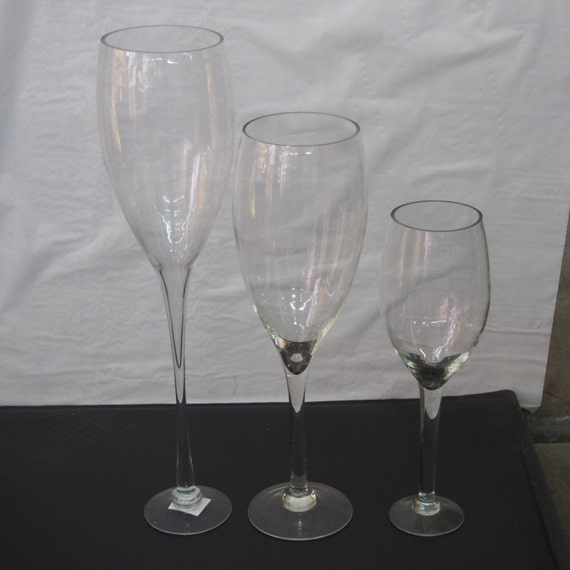 Tall champagne wine glass vase wedding centerpiece
