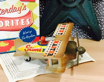 1990s Vintage Russ Yesterday's Favorites Stunt Master Wind Up Tin Airplane