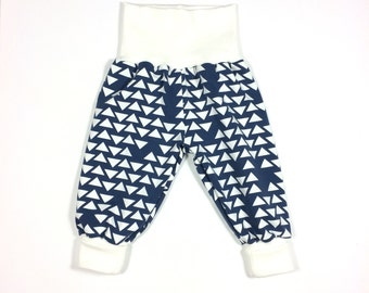 Blue harem pants with white triangles. Slouchy infant pants. Fold over waistband and cuffs. Blue cotton knit. Baby boy, baby girl, toddler
