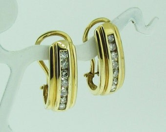 Vintage gold and diamond dangle earrings. Omega clasp.