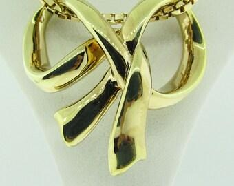 14 K gold vintage bow slide / pendant.