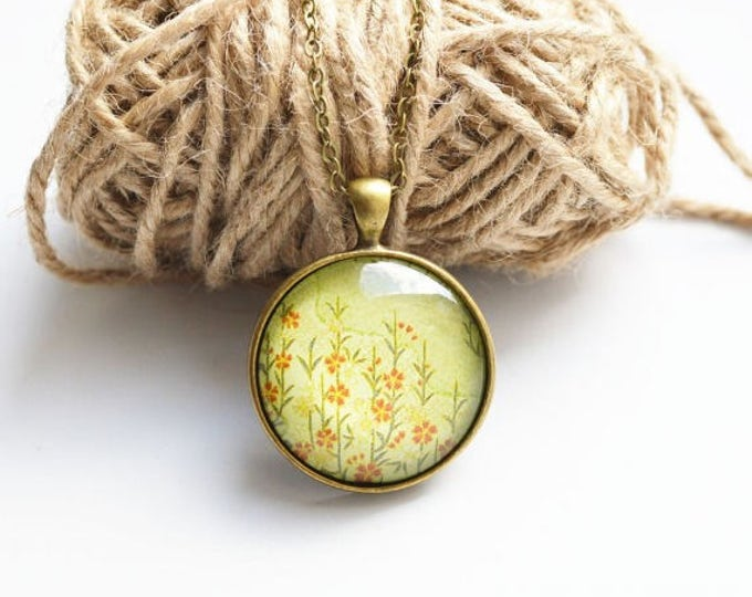 FLORAL MOTIFS Round pendant metal brass with flowers under glass