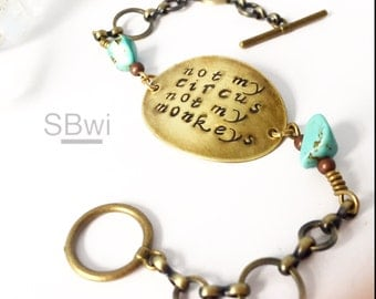 Not my circus not my monkeys bracelet in bronze with turquoise detail.