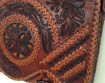 Beautiful thick leather, hand tooled messenger style shoulder bag .