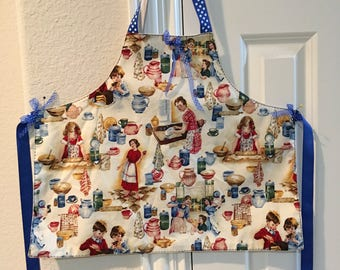 Two aprons with 1950's reproduction fabric
