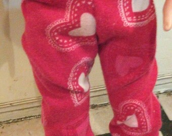 Leggings in red and white heart T shirt knit print with red leg bands. Made to fit American girl doll or other 18 inch doll.