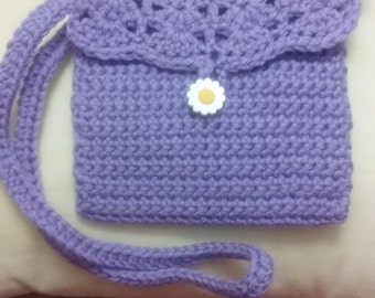 A crocheted crossbody bag for toddlers four to seven years old