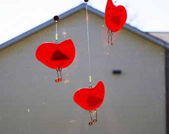 Rockin' Robin, tweet, tweet.  Translucent amber fused glass birdies dangling from a cherry tree branch.