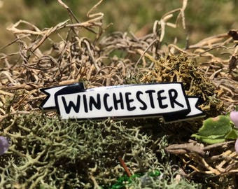 Winchester Banner Pin