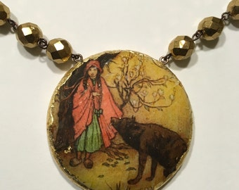 "Necklace with Pendant in gold leaf. ""Little Red Riding Hood"""