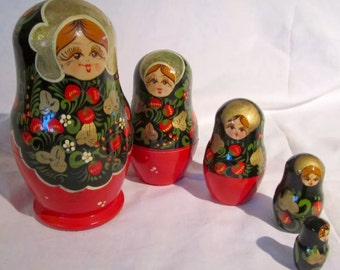 Set of Five Vintage Russian Nesting Dolls. Called babushkas, This lovely set of dolls were known as matryoshkas in the old USSR.