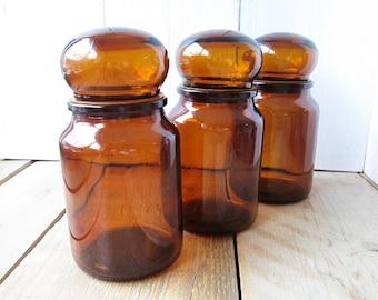 Set of 3 vintage brown apothecary bottles with lid. Glass bottles. Medicine bottles.