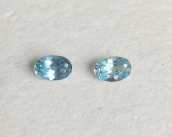 Natural blue topaz oval pair, 6x4 mm.