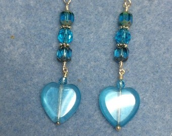 Turquoise Czech heart dangle earrings adorned with turquoise Czech glass beads.