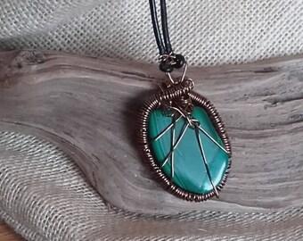 Malachite, rich dark green semi precious stone,copper wire wrapped & hung on leather cord.