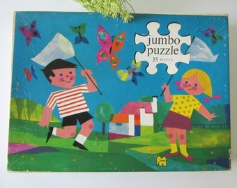 Vintage Puzzle with Children Catching Butterflies 901 made by Jumbo Holland 60s 16296