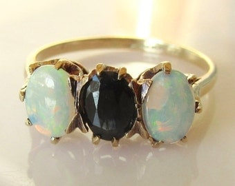 Gold Opal and Sapphire Three Stone Ring