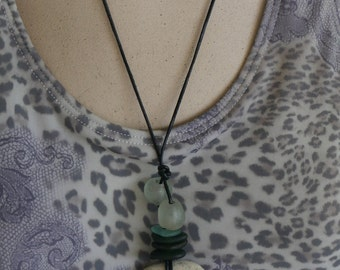 French Lime holey stone necklace with sea glass beads and recycled glass beads from Africa.