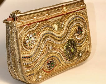 Handbag made from repurposed vintage jewelry makes a fancy clutch to dress up any outfit.
