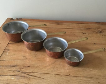 Set of 4 Vintage Copper Dry Goods Measuring Pots with Brass Handles in Decreasing Ounce Capacity
